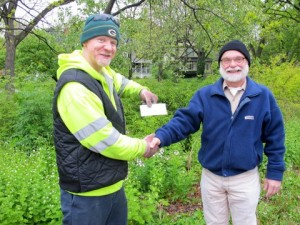Giving Mike a check for Arbor Day Tree